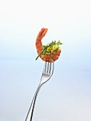 Prawn and herbs on a fork