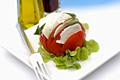 A tomato with mozzarella and basil