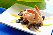 Prawns with dressing on oak leaf lettuce and mango