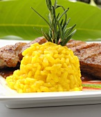 Saffron risotto served with roast duck breast