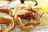 Soft pretzels on cake rack