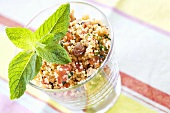 Couscous tabbouleh with vegetables, raisins and mint
