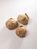 Three sesame seed rolls