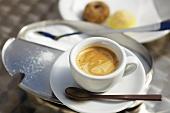 Espresso, a sugar tin and Italian biscuits