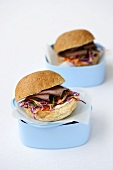 Wholemeal rolls with raw vegetables and roast beef
