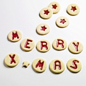 Jam biscuits spelling out MERRY XMAS