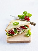 A ham, Camembert, tomato, cucumber and basil sandwich