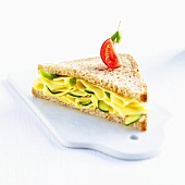 A cheese and gherkin sandwich on wholemeal bread