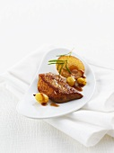 Fried foie gras with sliced apples, green grapes and rosemary