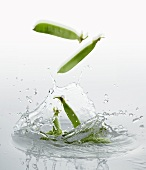 Pea pods falling into water