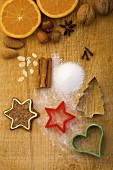 Christmas biscuits, baking ingredients and cutters, seen from above