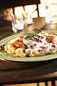 Breaded Chicken with Creamy Parmesan Sauce over Spaghetti
