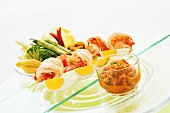 Spicy chilli dip, prawns and raw vegetables