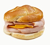Ham and Cheese Sandwich on Pretzel Roll; White Background