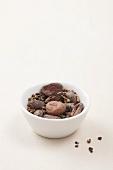 A bowl of cardamon seeds