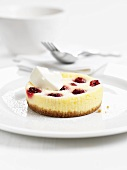 Mini cheese cake with raspberries and creme fraiche
