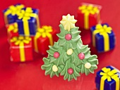 A sugar Christmas tree with presents in the background