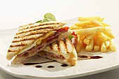 Toasted egg and bacon sandwich with chips