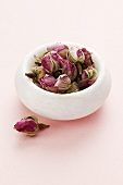 A bowl of rose buds
