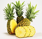 Pineapples, whole, halved and sliced
