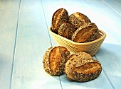 Spelt rolls in a bread basket and next to it