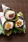 Temaki sushi with tuna, salmon and julieneed vegetables to take away