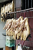 Plucked poultry hanging up at an Asian market