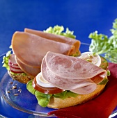 Bread roll halves with cold cuts