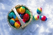 Coloured Easter eggs with a small basket