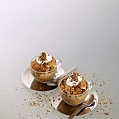 Home-made mocha ice cream in glass cups with whipped cream