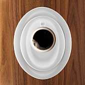 Coffee setting with black coffee on a wooden table