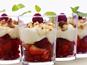 Berries with soft cheese topping in glasses