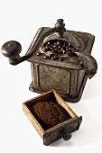 Nostalgic coffee mill with ground coffee