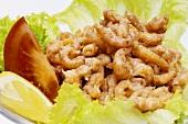 Shrimps on lettuce leaf