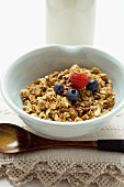 Muesli with berries in a small bowl