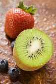 Half a kiwi fruit, blueberries and strawberry