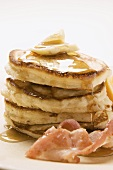 Pancakes with butter, bacon and maple syrup