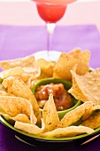 Tortilla chips and salsa in a bowl