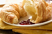 Croissant with jam on a plate