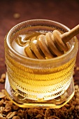 Honey dipper in a honey jar