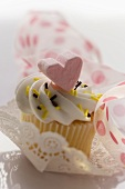 Muffin with heart decoration to give as a gift