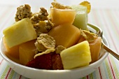 Pieces of fruit with cereal flakes