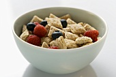 Shredded wheat cereal and berries in a cereal bowl
