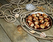 Platter of Bacon Wrapped Scallops; On Dock with Rope and Shells