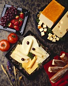 Assorted Cheese Slices on a Plate; Bread, Fruit and Cheese Blocks