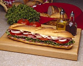 Salami and Provolone Submarine Sandwich on a Cutting Board