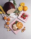 Turkey Sandwich on a Roll; Turkey on a Cutting Board; Strawberries