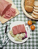 Sliced Corned Beef on a Plate with Cole Slaw on Shamrock Tablecloth