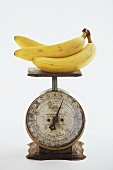 Bananas on an Old Metal Scale; White Background