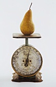 A Pear on a Metal Scale